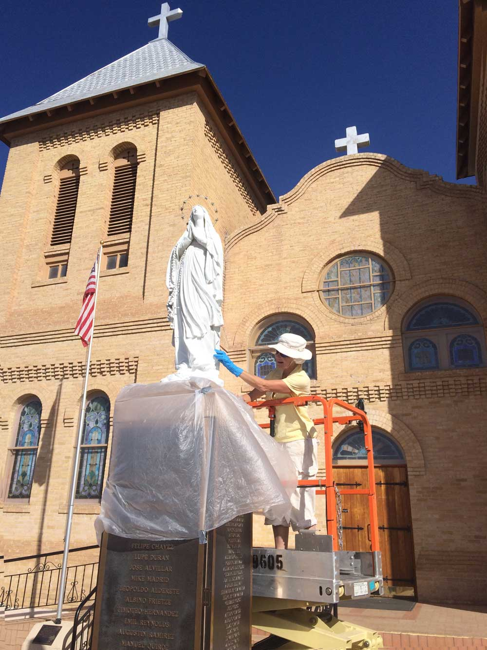 Virgin Mary statue restoration at Old Mesilla church in Mesilla New Mexico